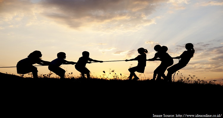 children playing tug of war