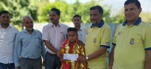 felicitates budding wrestler