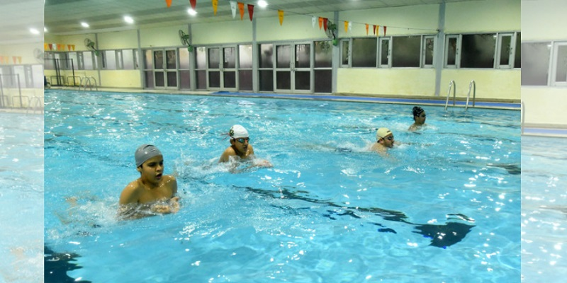 Young swimmers practise